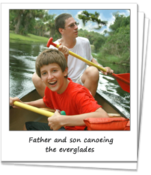 Father and son having fun canoeing through the everglades.