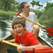 Father and son having fun canoeing through the everglades