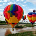 Lots of hot air balloons over a river