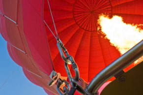 Flame filling a rising red balloon