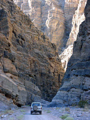 Vehicle driving through Titus Canyon, Death Valley National Park