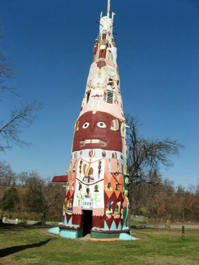 Large totem pole painted with faces and other patterns