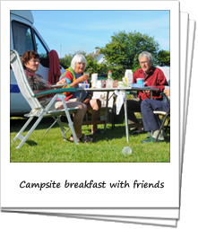 Seniors having breakfast together at a campsite