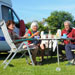 Four seniors having breakfast together at a campsite