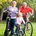 Grandparents biking with their granddaughter