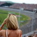 Lady fan watches the Superspeedway race