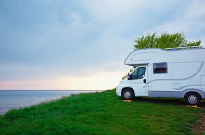 RV at campsite on leveling blocks