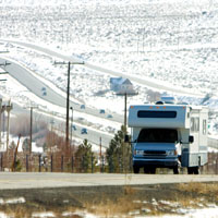 RV on the road with snow all round