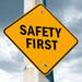 Yellow safety first road sign