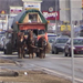 Horse drawn wagon on busy road