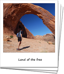 Hiker under Corona arch, Bureau Land Management Recreation Area