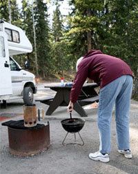 Man cooking on a camp grill
