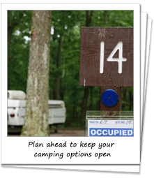Occupied sign at campsite with trailer