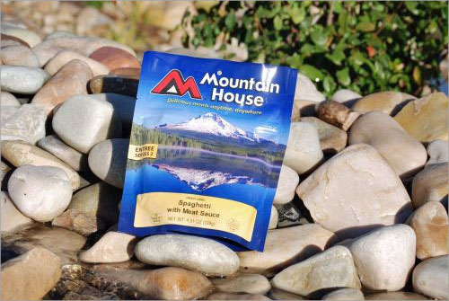Mountain House Freeze Dried Food packet lying on some stones