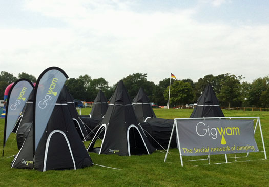 Multiple Black 2 Person Gigwam Tents connected together and setup in a field