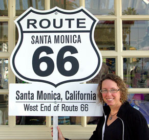 Sandi next to west end of Route 66 Santa Monica California sign