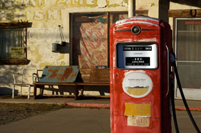 Old red gas pump in station