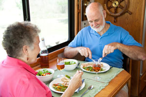 Couple in an RV eating a healthy meal