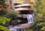 Frank Lloyd Wright Falling Water house with waterfall beneath it