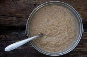 Tin bowl of sloppy oatmeal