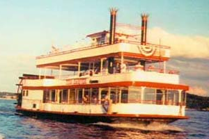 A paddlewheel boat floats along Ozark Lake