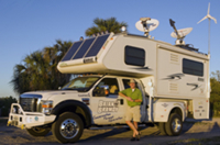 Brian Brawdy stands outside his wind and solar powered RV