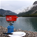 Pot on camping stove by scenic mountain lake