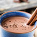 Hot chocolate with a cinnamon dipped in it