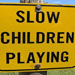 Campground sign that reads slow children playing