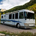 Class A motorhome parked in a mountain setting