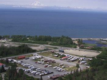 Aerial view of Alaskan Angler RV Resort with the sea in the background