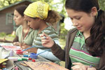 Girls doing crafts at camp
