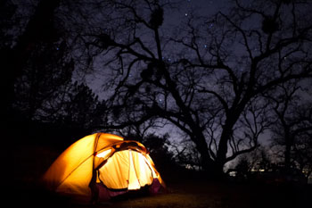 Lit tent camping outdoors