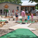 A family enjoying mini golf at Amigo's Mini Putt Golf