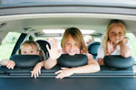 3 little girls in back seat of car