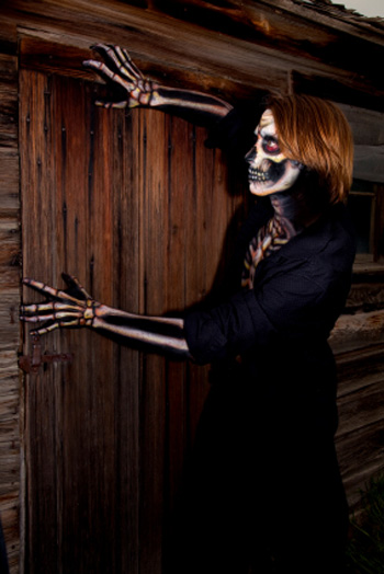 Skeleton prop at a door in a haunted house