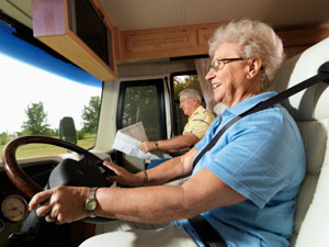 Senior woman driving an RV