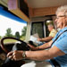 Senior woman driving a Class A motorhome