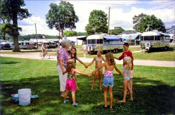 Children hold hands in a circle