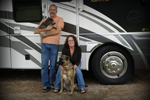 Keith and Tricia with their fluffy kids in front of their RV.