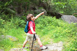Little child hiking and pointing