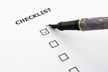 Pen tick a box on a checklist
