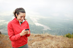 Female hiker using a smartphone