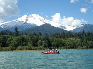 Baker Lake with a raft and Mount Baker covered in snow in the background