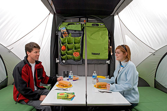 Interior view of the SylvanSport GO Camper Trailer with a couple sitting at a table