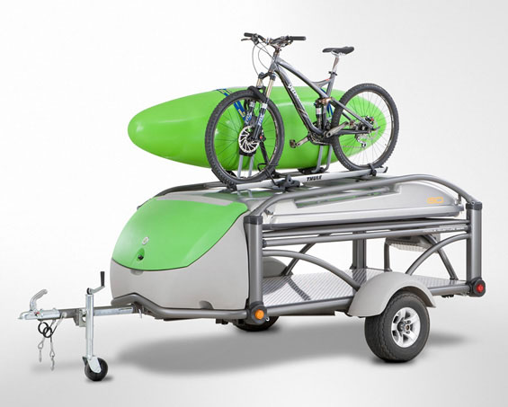 SylvanSport GO Camper Trailer with bike and canoe tied on top