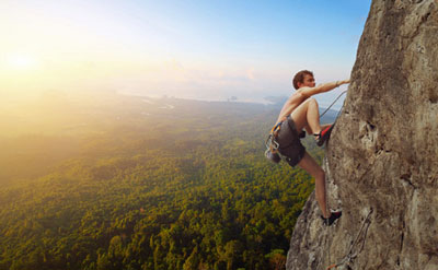 Climber on a rock with background scenic view