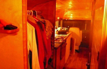 Interior shot of RV bus - wardrobe and kitchen