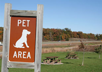 A park sign that states 'Pet Area'.