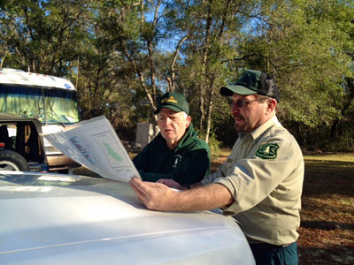 Brett Bush, Ocala National Forest Ranger studying a Forest Service Map